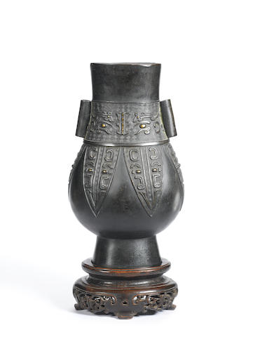 An archaistic bronze arrow vase, hu 17th/ 18th century
