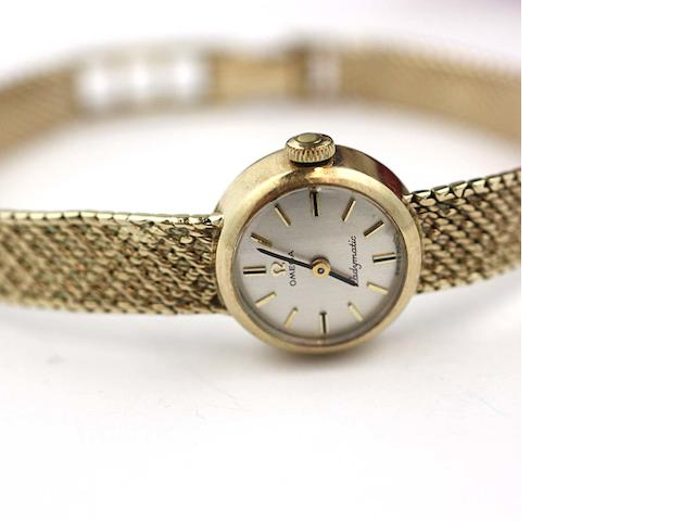 Omega: A 9ct gold Ladymatic bracelet watch