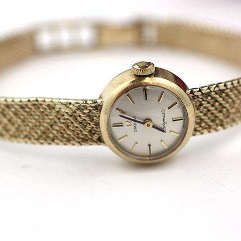 Omega: A 9ct gold Ladymatic bracelet watch