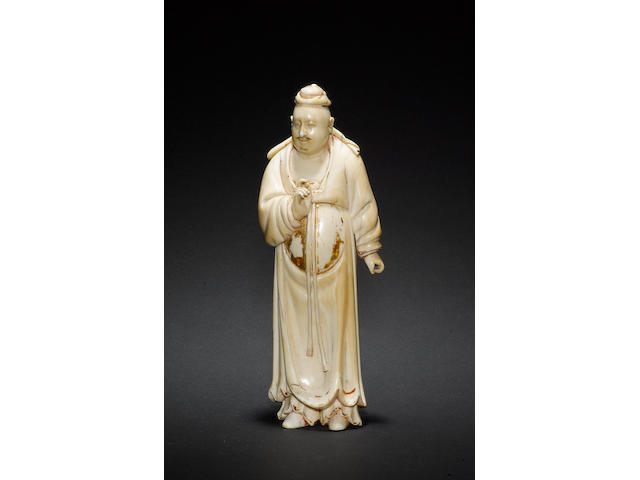 An ivory figure of a standing scholar or official Early/mid Qing Dynasty