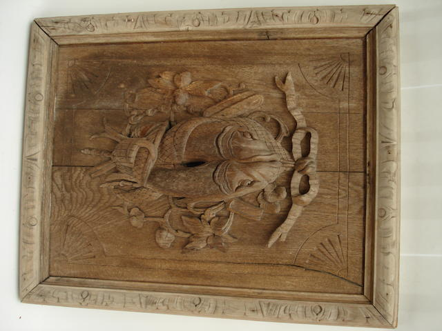 A Victorian carved oak panel
