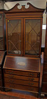 An Edwardian inlaid mahogany bureau bookcase,