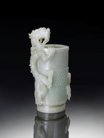 A pale green jade 'dragon' cup 18th century