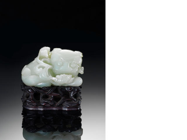 A pale green jade carving of a Buddhist lion 17th/18th century