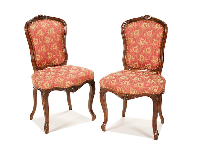 A pair of mid 18th century French carved walnut side chairs