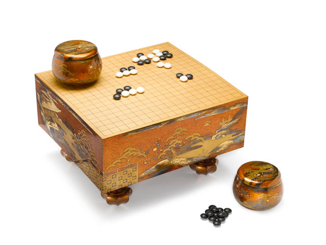 A traditional lacquered-wood go-ban (games board) set Meiji Period