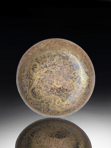 A rare jade gilt decorated 'dragon and phoenix' saucer-dish Gilt four-character Qianlong mark and of the period