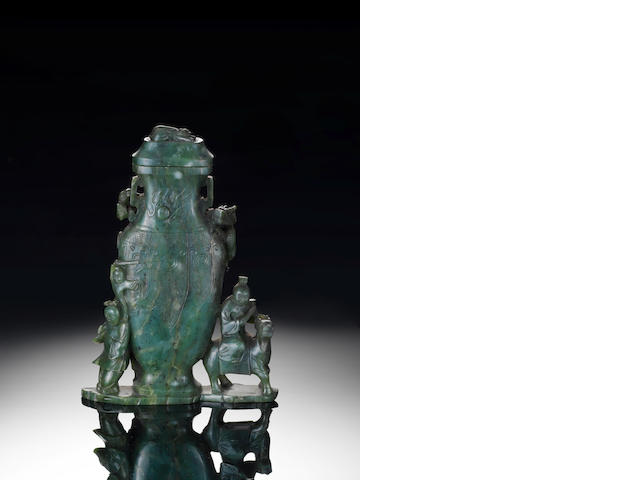 A spinach green jade figural vase group and cover Qianlong/ Jiaqing