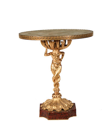 A gilt metal and onyx figural stand