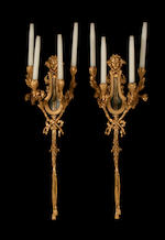 A large pair of Louis XVI style gilt metal four branch wall lights