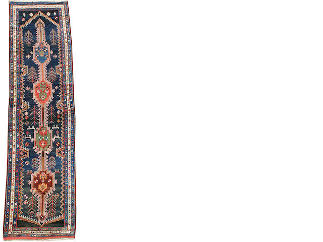 A South Caucasian runner 12 ft 8 in x 3 ft 4 in (387 x 104 cm) some minor wear