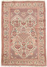 A pair of Kashan rugs Central Persia, each approx. 6 ft 6 in x 4 ft 5 in (198 x 135 cm)