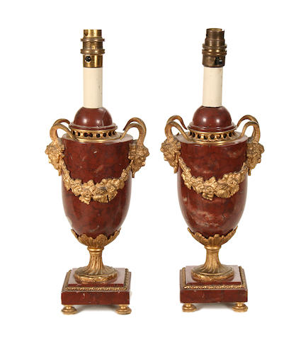 A small pair of Louis XV style Rouge Griotte marble and gilt metal mounted urns mounted as lamp bases