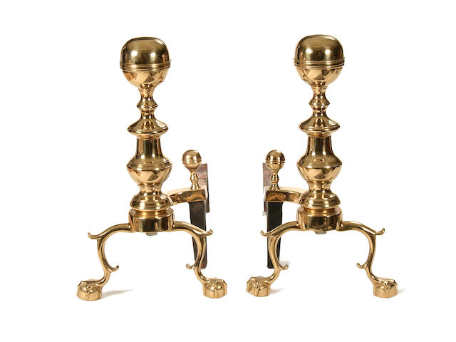 A pair of 18th century style brass and iron fire dogs