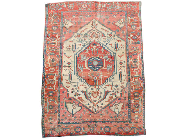 A Serapi carpet North West Persia, 13 ft 1 in x 9 ft 9 in (400 x 298 cm) some wear and damage