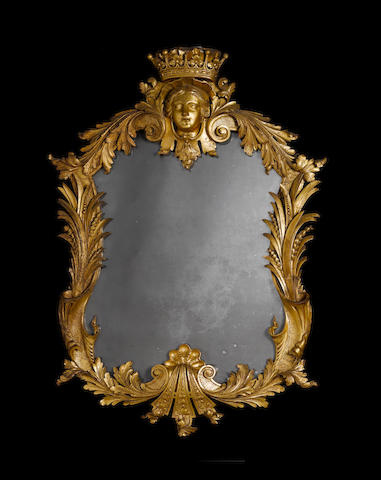 A rare and important pair of George II carved giltwood mirrors Probably supplied to Henry Howard, 4th Earl of Carlisle
