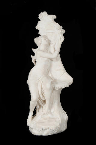 Edouard Drouot, French (1859-1945) An alabaster figure of a nymph at a well