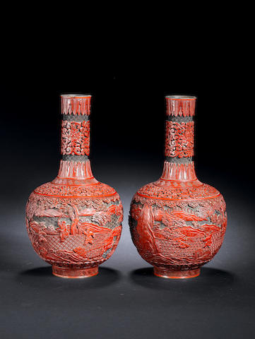 A pair of carved cinnabar lacquer 'boys at play' bottle vases Qianlong/Jiaqing