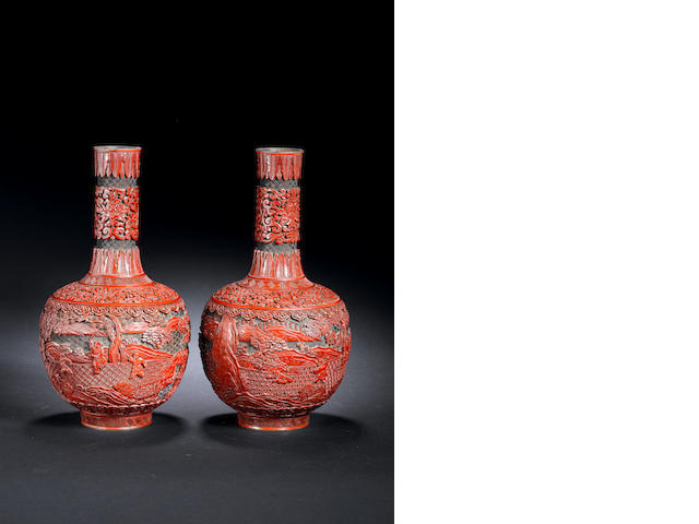 A pair of 'boys at play' cinnabar lacquer bottle vases Qianlong/ Jiaqing