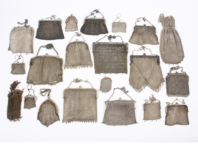 A collection of silver and electroplated chain mail evening bags and coin purses