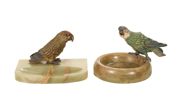 Two early 20th century Viennese cold painted bronze models of parrakeets mounted on onyx ashtrays