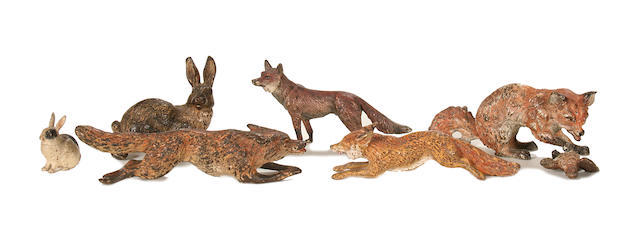 A collection of four late 19th century Viennese cold painted bronze models of foxes together with two rabbits