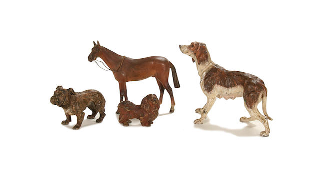 Three late 19th century Viennese cold painted bronze models of dogs together with a horse