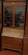 An Edwardian mahogany inlaid bureau bookcase,enclosed by a pair of astragal glazed doors above a sloping fall and three drawers, 94cm wide.