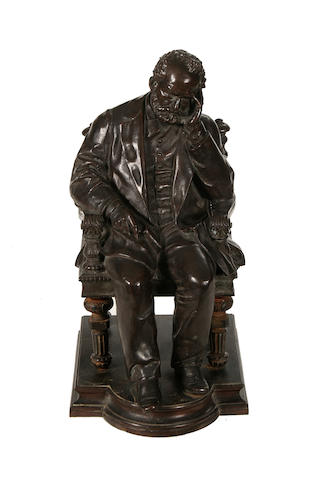 A late 19th / early 20th century bronze figure of a seated man