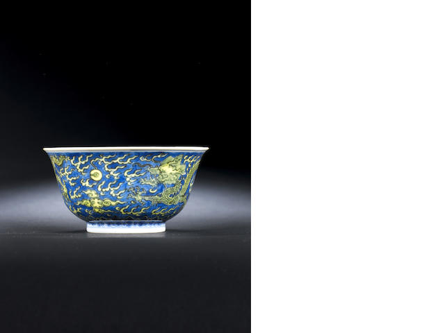 A blue and white and yellow enamelled bowl Six character Kangxi mark and of the period