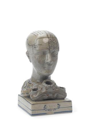 An F. Bridges ceramic phrenology head inkwell