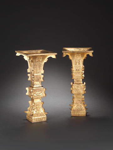 A pair of archaistic gilt-bronze beaker vases, gu 17th/18th century