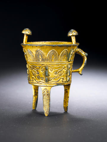 A small archaistic gilt bronze tripod jia Late Ming