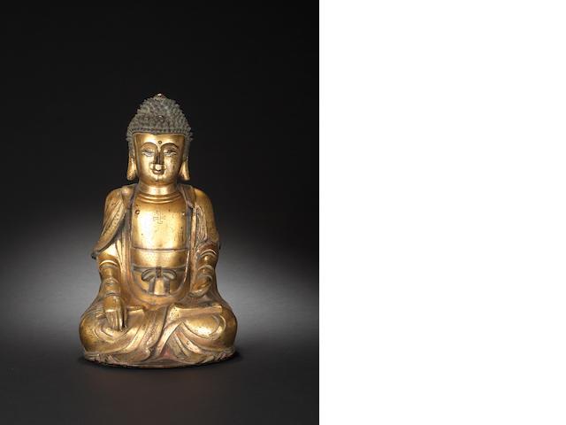 A gilt bronze figure of Sakyamuni Buddha 17th/18th century