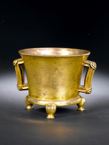 A gilt-bronze tripod two-handled bowl Cast Xuande six-character mark, 17th/18th century