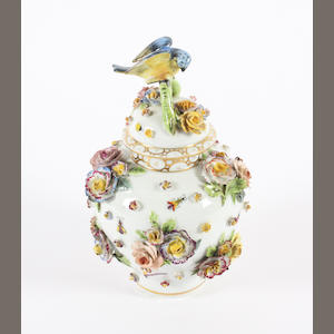 A Carl Thieme small vase and cover and a Furstenburg figure group Late 19th Century.