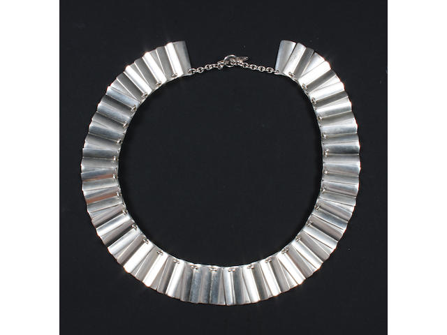 A Georg Jensen necklace Numbered 113, with stamped marks and import marks for London, 1967,