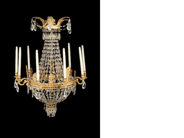 A late 19th / early 20th century Empire style gilt metal and cut glass chandelier