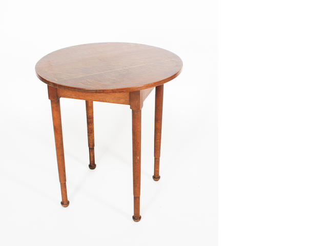 An oak circular table by Heales and Son, 69cm diameter.