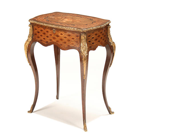 A French late 19th century rosewood, patridgewood, marquetry, parquetry and gilt metal mounted work table