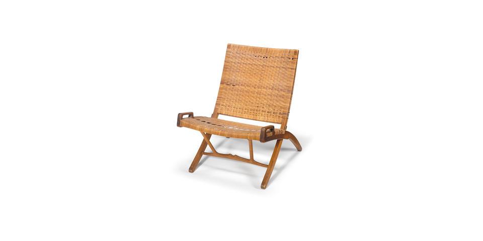 Hans Wegner for Johannes Hansen, a folding chair, designed 1949 oak and cane,