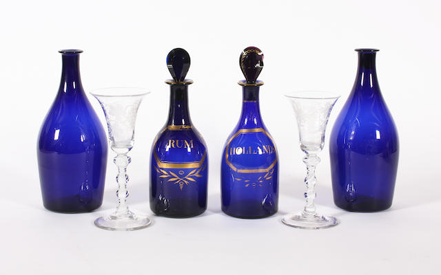 A pair of gilt blue-tinted spirit decanters and stoppers Circa 1800.
