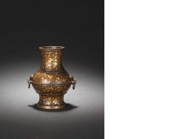 A small gilt-splashed bronze vase, hu Cast Xuan mark, 17th century