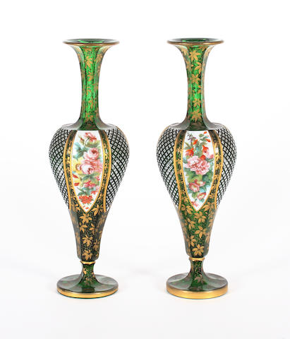 A pair of Bohemian overlaid green glass vases Circa 1900.