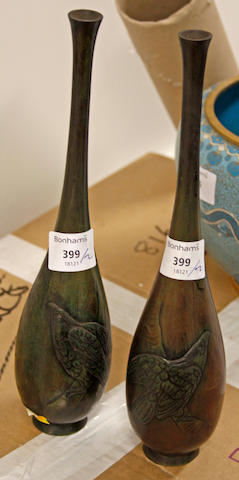 A pair of Japanese bronze slender bottle vases,with bas rlief decorated eagles,30cm high. (2)