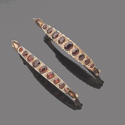 A pair of garnet bangles, (2)
