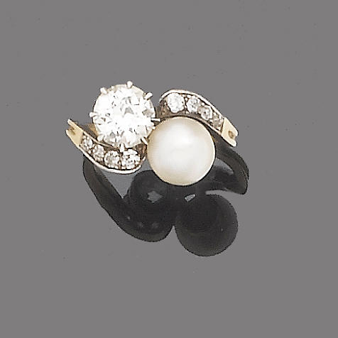 An early 20th century pearl and diamond two-stone ring