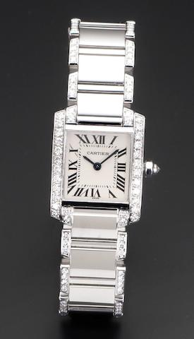 Cartier. A lady's 18ct white gold diamond set quartz bracelet watchTank Française, Reference 2403, Case Number MG283945, Recent