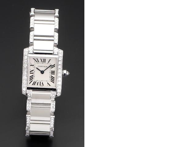 Cartier. A lady's 18ct white gold diamond set quartz bracelet watch Tank Française, Reference 2403, Case Number MG283945, Recent