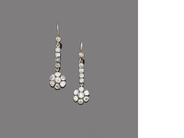 A pair of diamond pendent earrings,